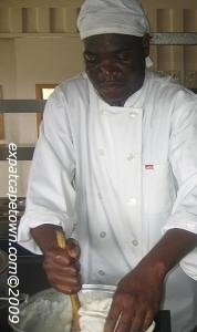 Chef cooking typical African mealie pap