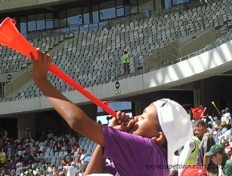 Child blowing a vuvuzela